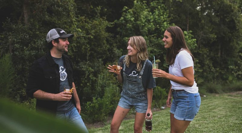 woman in black crew neck t-shirt and blue denim shorts standing beside woman in white