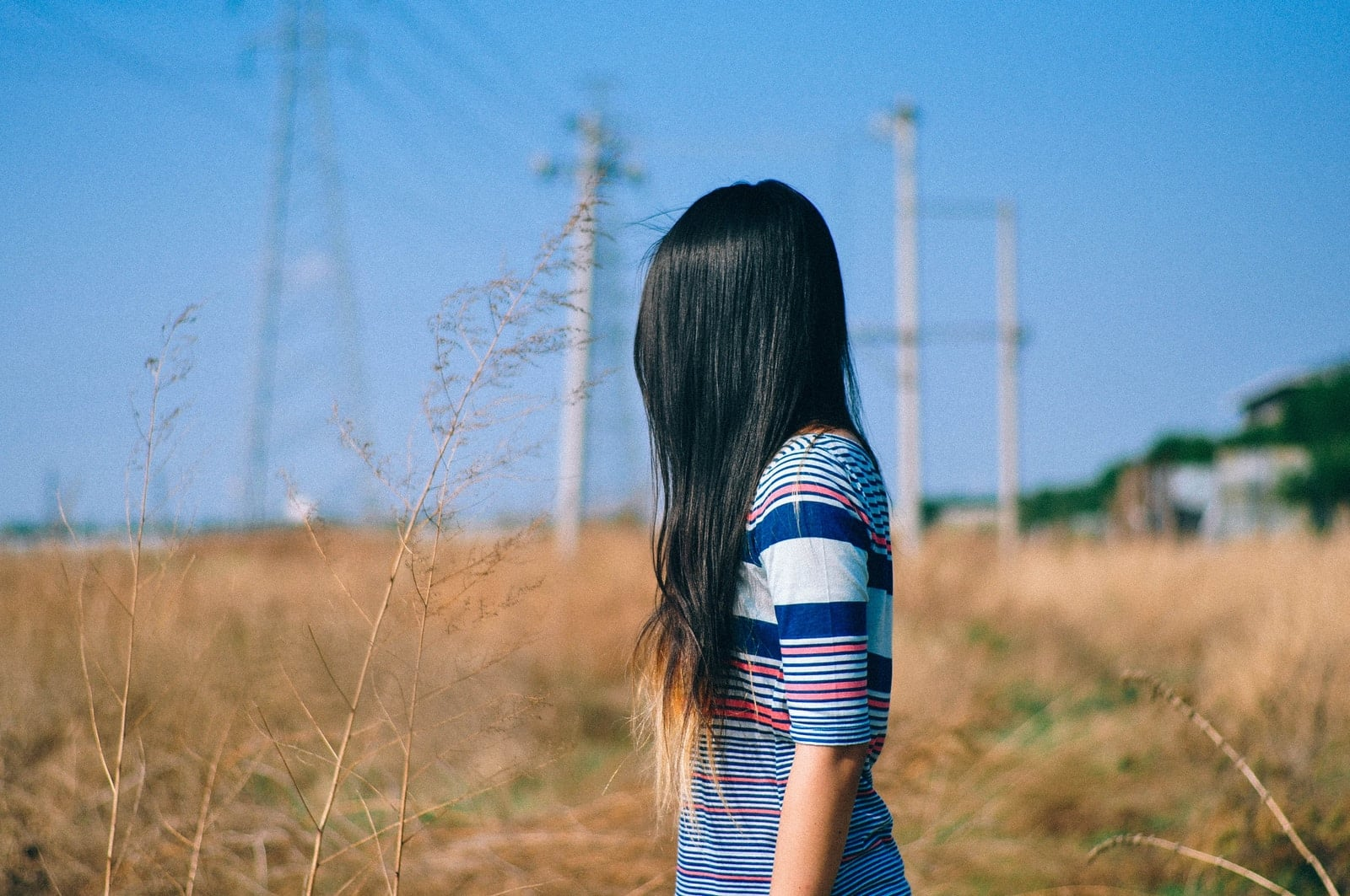 selective focus photography of woman standing near outdoor during daytime